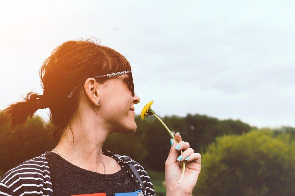 girl smeeling flower